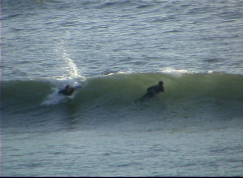 A man successfully surfs across a small wave Stock Video Footage