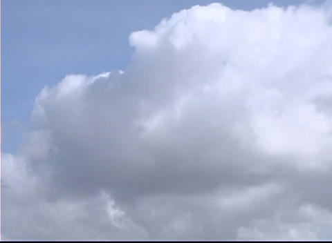 A large mass of clouds move together into different... Stock Video Footage