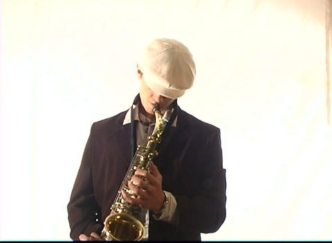 A man plays the saxophone with passion Footage