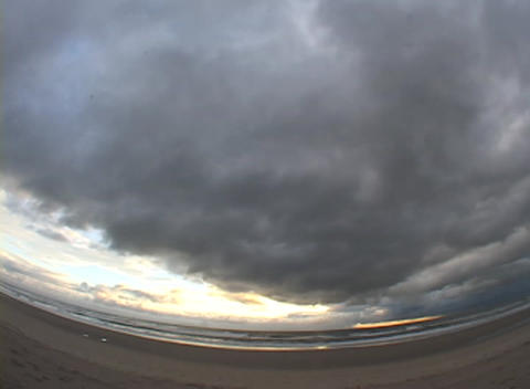 A time-lapse view of clouds and traffic moving quickly... Stock Video Footage