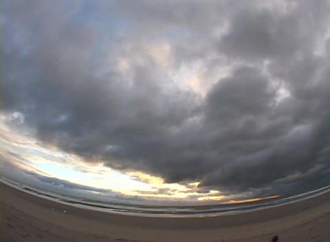A time-lapse view of clouds and traffic moving quickly throughout the day Footage