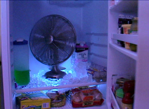 A fan blows in the inside of a refrigerator Stock Video Footage