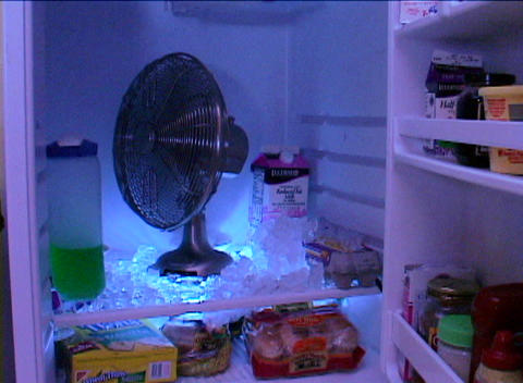 A fan blows in the inside of a refrigerator Footage