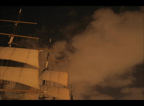An accelerated shot of clouds flowing past the masts of... Stock Video Footage