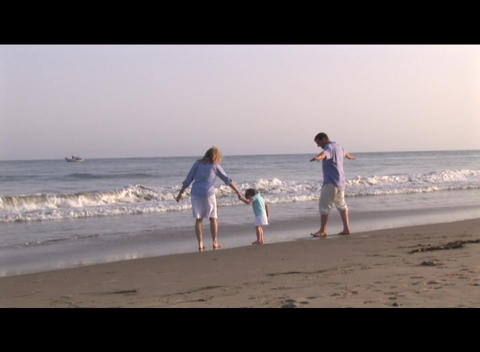 Medium shot of family playing on the beach Stock Video Footage