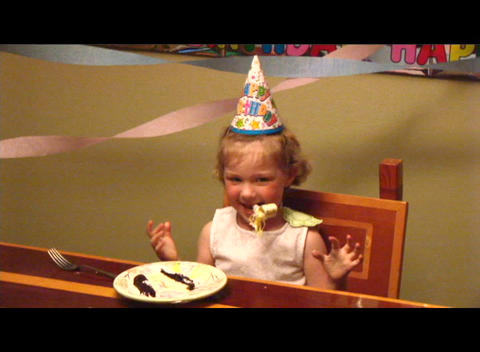 Medium shot of a little girl blowing a party favor Stock Video Footage