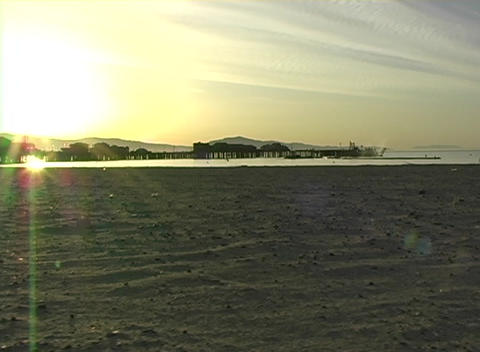 Long-shot of buildings in silhouette on the coast at... Stock Video Footage