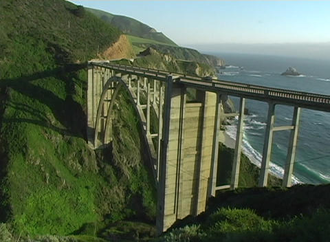 A bridge over rugged coastal terrain makes traveling easier Stock Video Footage