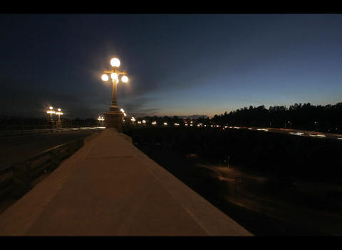 A time-lapse shot of a freeway median, street-lights, and... Stock Video Footage