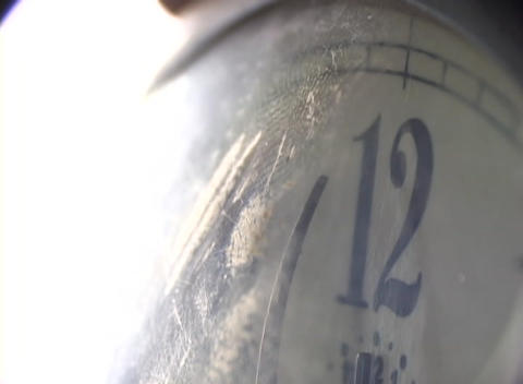 Time seems warped in this extreme close-up, as the minute hand on a vintage clock slowly moves towar Footage