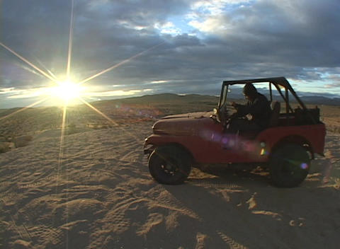 Medium shot of a vehicle in the desert and a person run,... Stock Video Footage