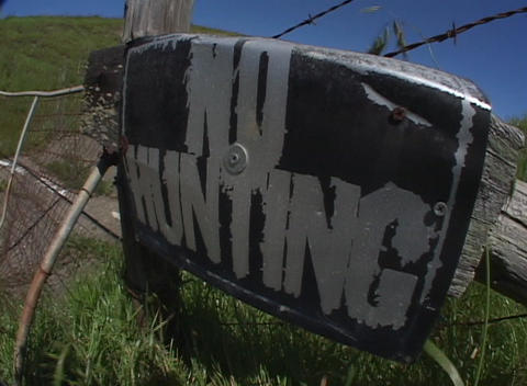 "Medium shot in the country with a large No Hunting"" sign... Stock Video Footage"