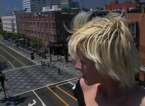A time-lapse of a busy city intersection seen from the perspective of a girl looking down on it Footage