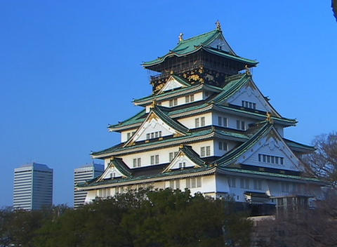Five-story temple, with all its graceful curves, stands out in sharp contrast with the modern skyscr Footage