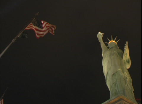 Low-angle shot of the Statue of Liberty, and US flag in... Stock Video Footage