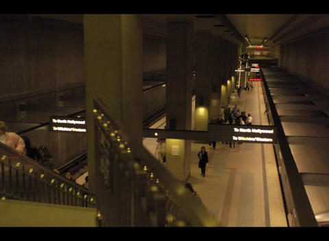 People and trains arrive and depart from an underground... Stock Video Footage