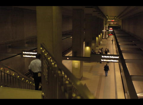 People and trains arrive and depart from an underground station in this accelerated shot Footage