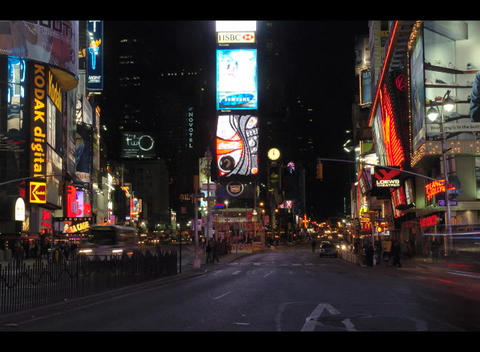 An accelerated shot of people and traffic moving through Times Square at night Footage