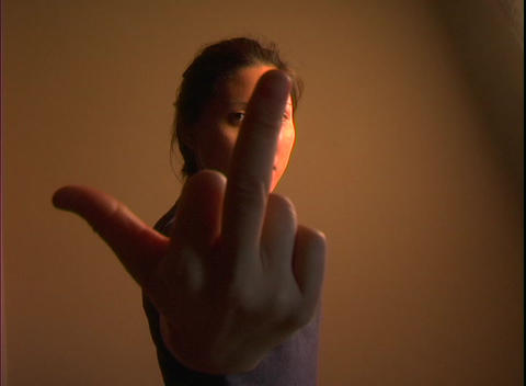 A woman thrusts her middle finger in an obscene gesture Stock Video Footage