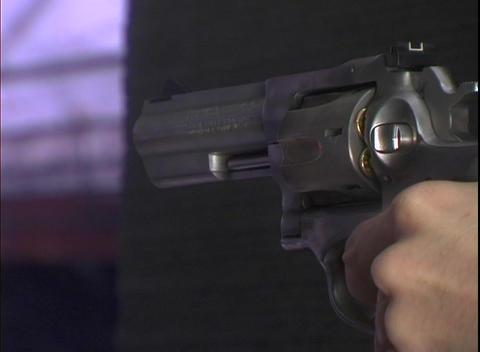A man fires a revolver Footage