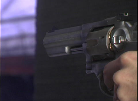 A man fires a revolver Stock Video Footage