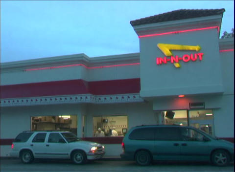 Patrons pick up food at the busy In-and-Out drive through... Stock Video Footage