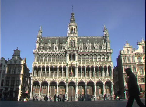 Pedestrians walk by the Grand Place in Brussels, Belgium Stock Video Footage