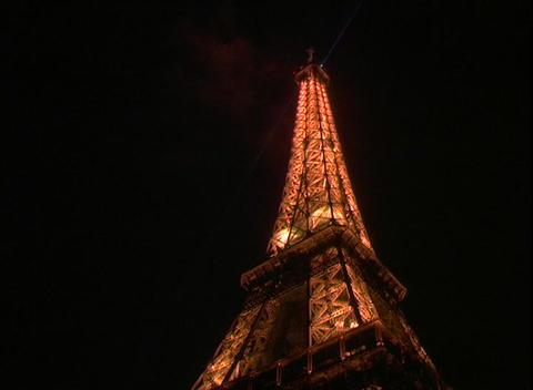 Twinkling lights illuminate the Eiffel Tower in Paris,... Stock Video Footage