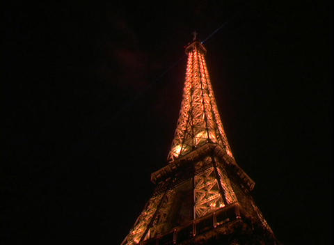 Twinkling lights illuminate the Eiffel Tower in Paris, France Footage