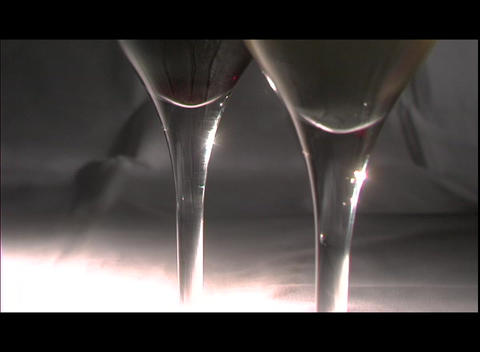 Red and white wine fill two wine glasses Stock Video Footage