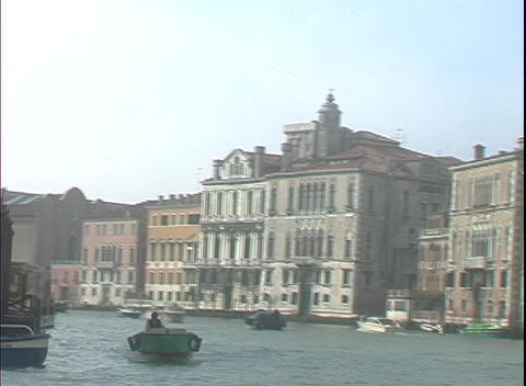 Apartment buildings line either side of the Grand Canal in Venice Footage