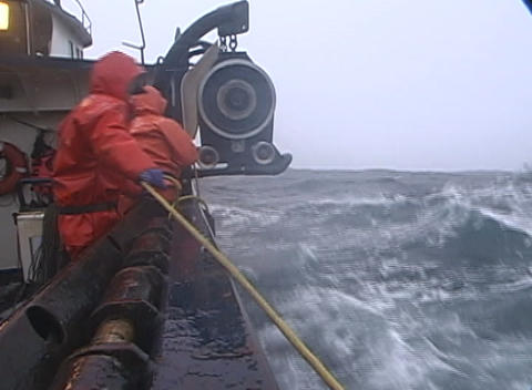 lobster fishermen struggle to attach a rope to a machine... Stock Video Footage