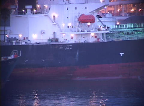 Medium shot of container ship passing another ship in a... Stock Video Footage