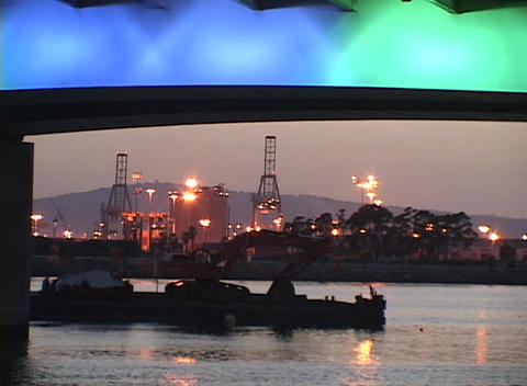 Tracking-out of an oil refinery and colorfully-lighted... Stock Video Footage