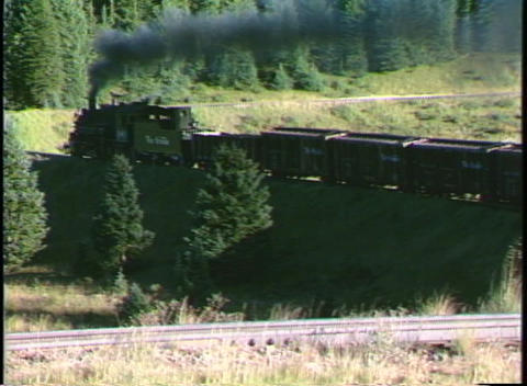 Following shot of a Rio Grande steam freight train... Stock Video Footage