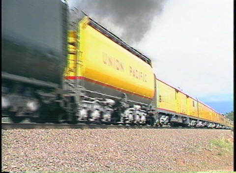 Tracking-left shot of a Union Pacific steam passenger train Footage