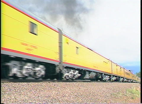 Tracking-left shot of a Union Pacific steam passenger train Stock Video Footage