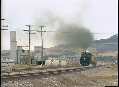 Pan-left shot of a Union Pacific steam train passing by... Stock Video Footage