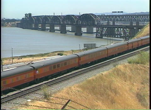 Zoom-out of a Southern Pacific train passing by a large... Stock Video Footage