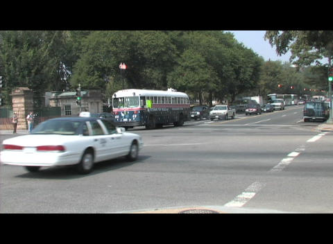 A Veterans for Peace bus crosses an intersection in... Stock Video Footage