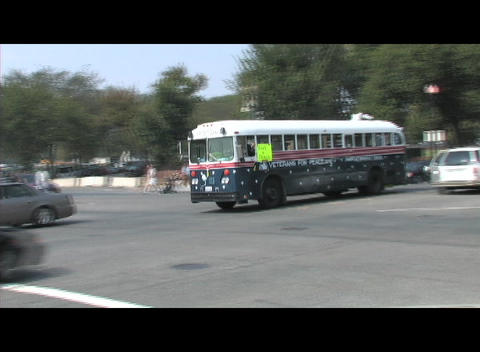 A Veterans for Peace bus crosses an intersection in Washington DC Footage
