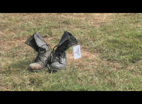 Medium-shot of a pair of combat boots symbolizing the loss of soldiers in the Iraq War Footage