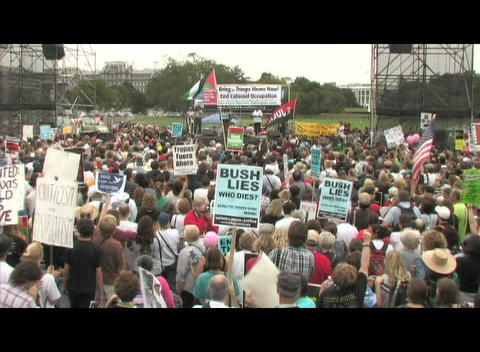 Medium-shot of Iraq war protesters gathering outside the... Stock Video Footage