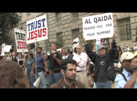 Handheld-shot walking through a religious anti-war protest Stock Video Footage
