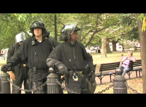 Riot police waiting in a park in Washington DC Stock Video Footage