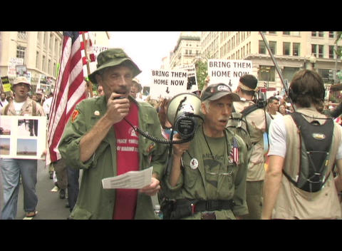 Medium-shot of anti-Iraq-war protestors marching in... Stock Video Footage