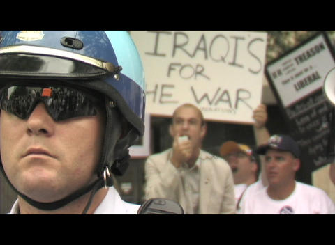 Close-up of a policeman's face during Iraq-War demonstration in Washington DC Footage
