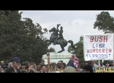 Medium-shot of a groups of anti-Iraq-war protestors in... Stock Video Footage