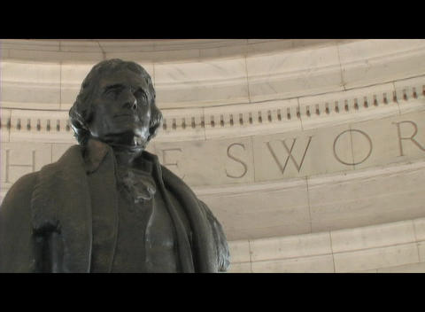 Medium-shot of the Thomas Jefferson statue in the Memorial in Washington DC Footage