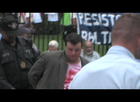Medium-shot of the arrest of a Caucasian anti-war protestor at a Washington DC rally Footage